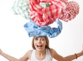 woman throws a pile of clothes