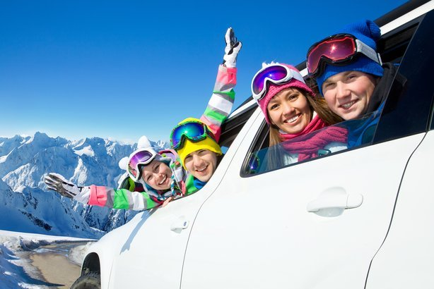 family traveling by car on a vacation to the mountains