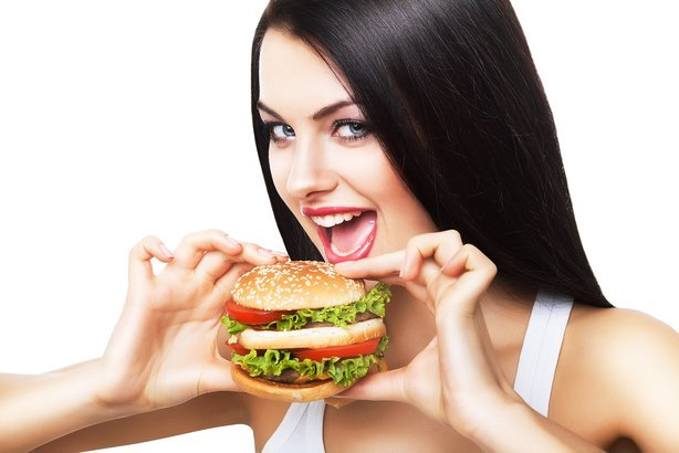 woman biting hamburger