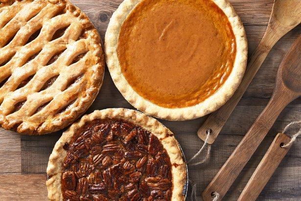 overhead view of three pies: pecan, apple and pumpkin