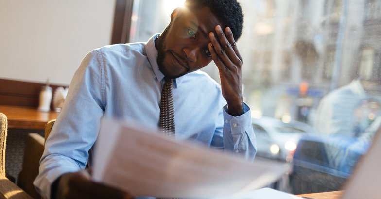 stressed African American working at desk