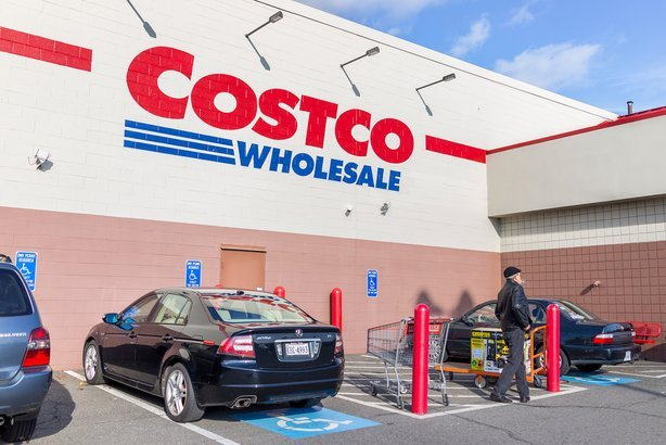 Costco with parked cars and customers walking