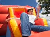 child having an accident on bounce house
