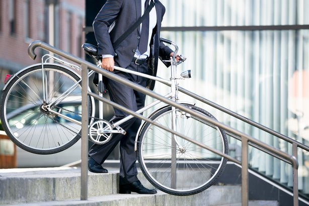 business man and his bicycle, concept bike go to work