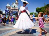 Mary Poppins dances with a child at Disneyland