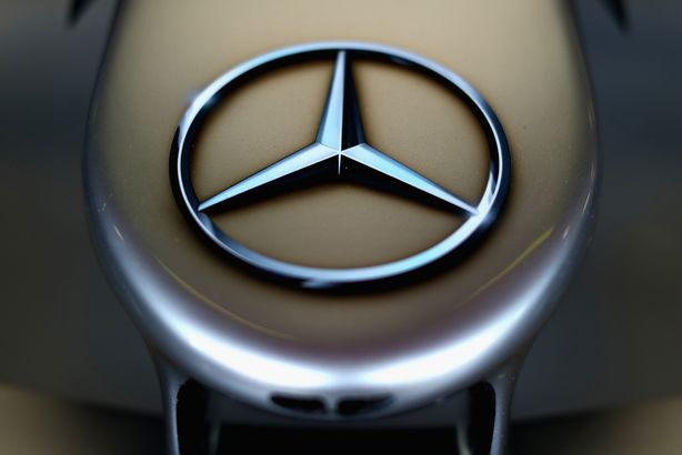 Mercedes logo on the car in the garage