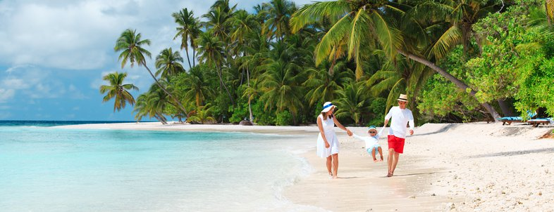 family with kid playing on beach