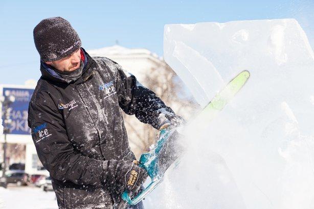 sculptor working on ice sculpture