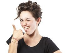 woman with thumbs up gesture saying 'yeah!'