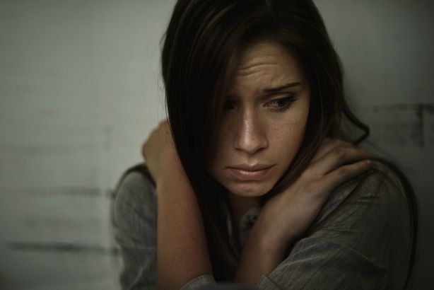 depressed and worried woman in the dark