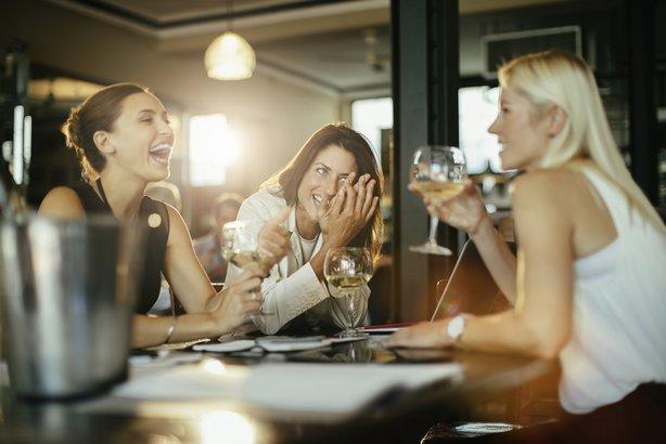 three women having brunch in a restaurant