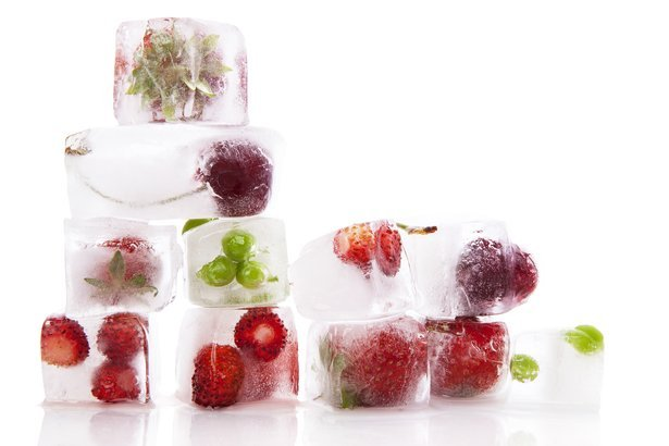 fresh fruits and vegetable frozen in ice cubes