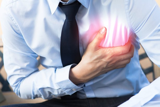 man in office uniform having heart attack