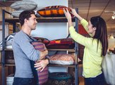 couple shopping for cushions at home decor store