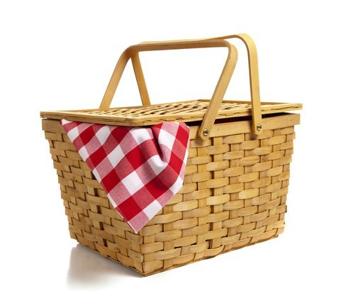 wicker picnic basket with a red gingham cloth
