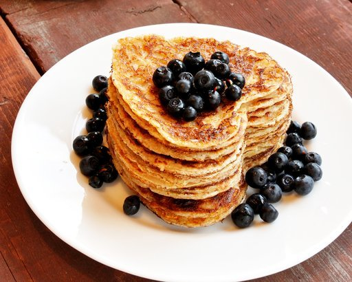 heart-shaped pancakes with blueberry on wooden table
