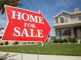 arrow shaped 'Home For Sale' sign