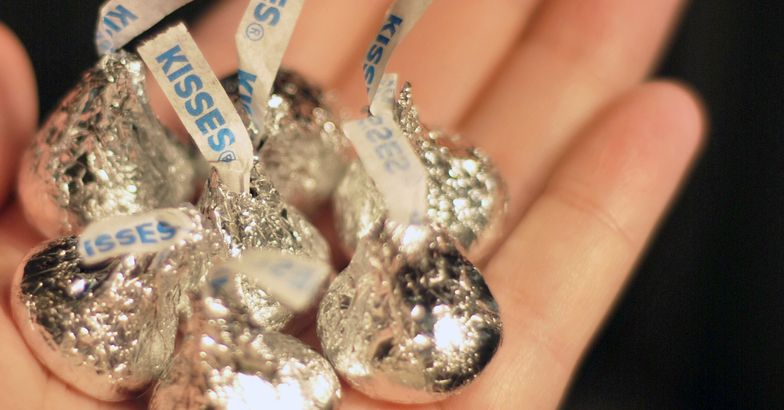 hand holding Hershey Kisses in palm