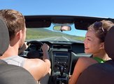 couple driving car on road trip travel vacation in convertible