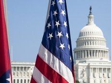 American flag with the US Capitol in the background