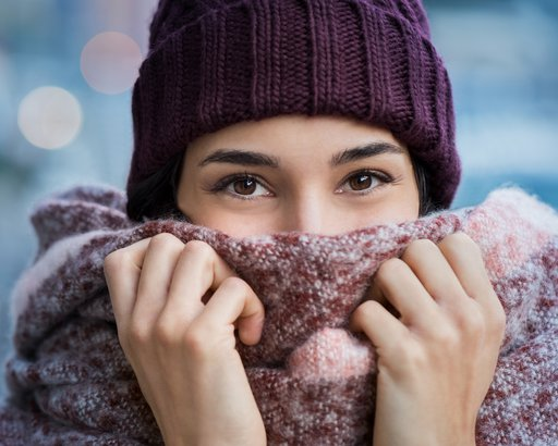 woman peeking out from scarf