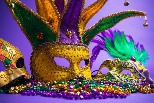 festive Mardi Gras party masks and beads