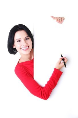 woman writing with a pen on blank board