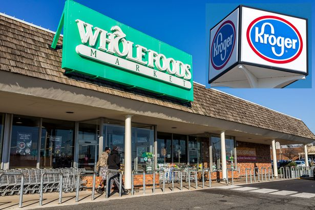 Whole Foods store and Kroger store sign