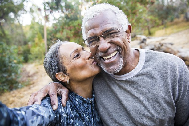 senior African American couple taking selfie during exercise