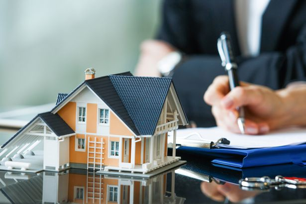 people signing purchase agreement for new house