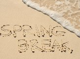 the words 'Spring Break' written in the sand on a beach
