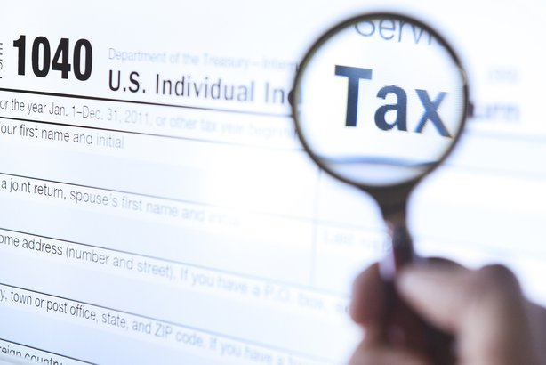 magnifying glass on tax form 1040