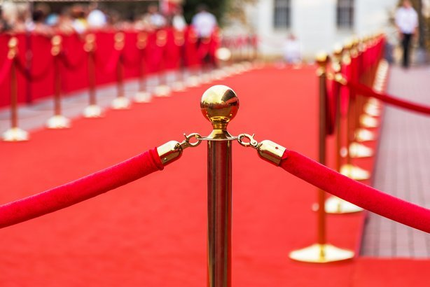 red carpet with barrier rope