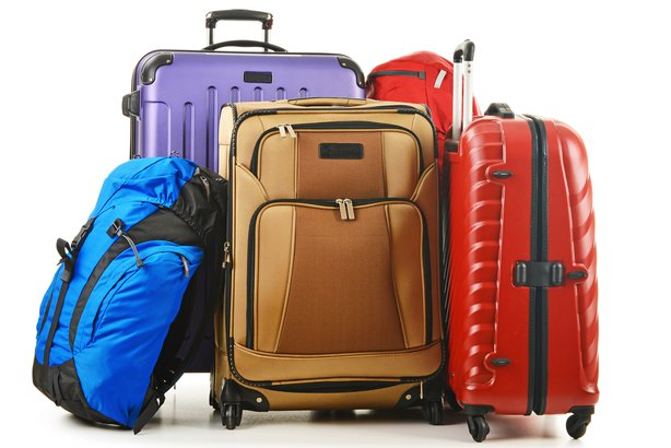 Collection of luggage in different shapes, sizes, and colors