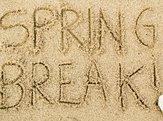'Spring Break!' written in sand