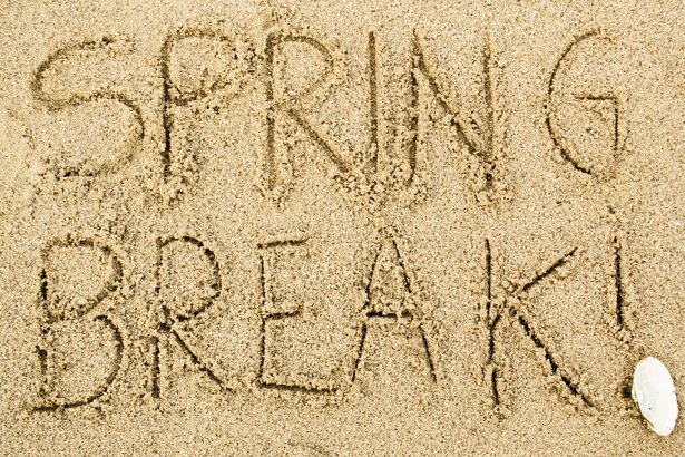 'Spring Break!' written in sand