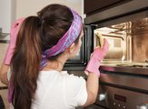 woman cleaning microwave