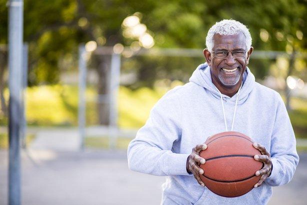Senior man playing basketball