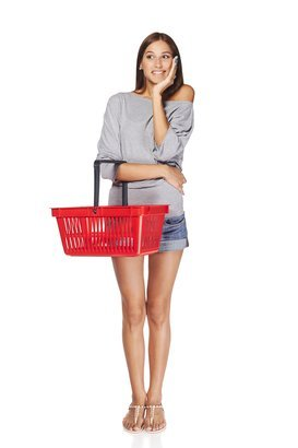 55ffe49764 surprised casual young woman standing smiling with empty shopping cart  basket