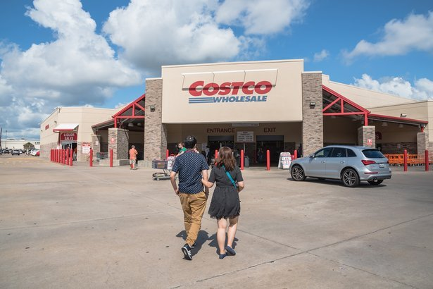 Costco Wholesale store front with customers walking in