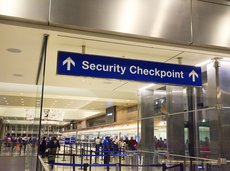 Security checkpoint sign in an airport