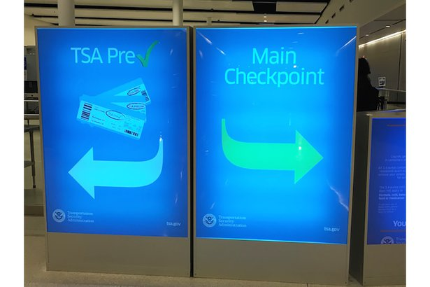 Sign for regular boarding and TSA Precheck at the airport