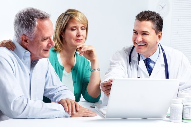 smiling medical doctor with senior couple