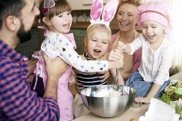 parents and their children baking together for Easter