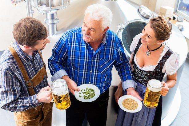 brewer and couple in beer brewery guided tour