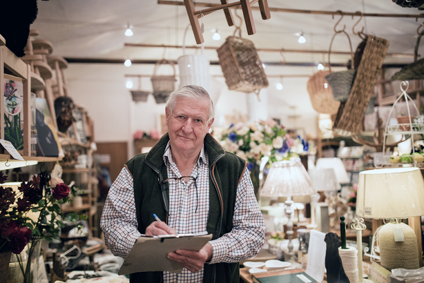 Retired man working in an antique shop