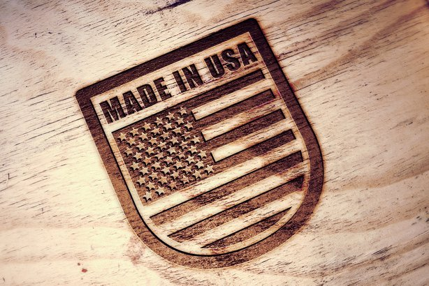 'Made in USA' symbol engraved on wooden board