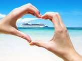 cruise ship in the sea near the tropical island inside hands making heart shape