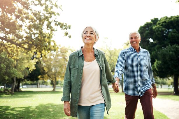 Happy and peaceful senior couple walking outside