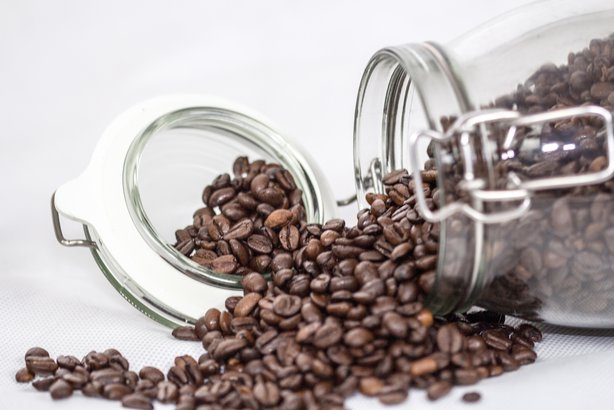 coffee beans spilling out of glass container